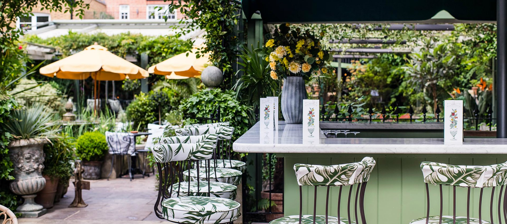 The Ivy Chelsea Garden Alfresco Dining Amongst Fountains Firepits